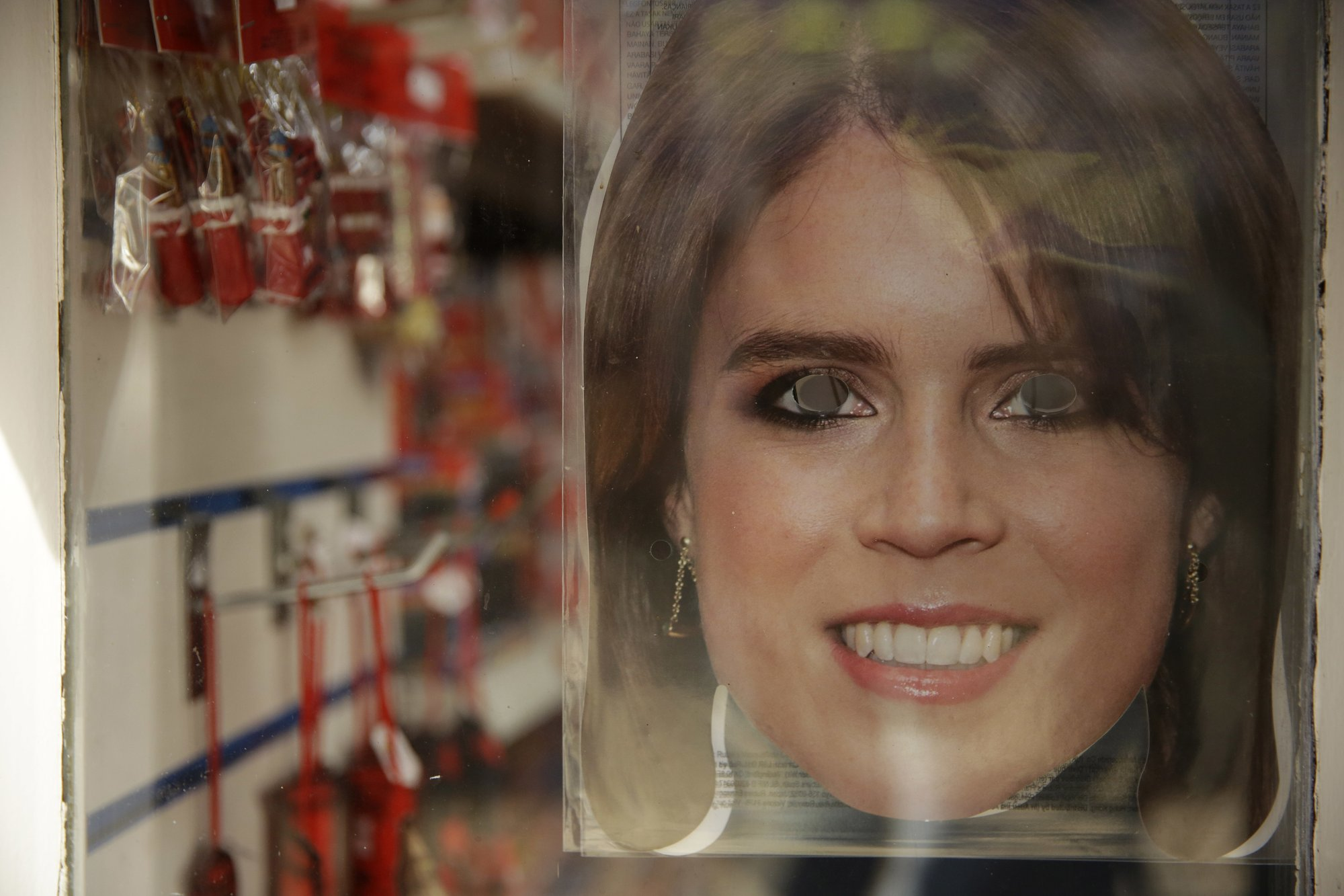 A Princess Eugenie mask is displayed for sale in the window of a souvenir shop ahead of the wedding of Britain's Princess Eugenie in Windsor, England, on Wednesday, Oct. 10, 2018. Photo: AP