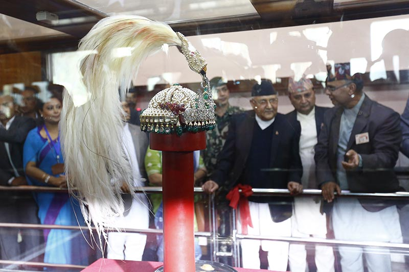 Prime Minister KP Sharma Oli observing the royal crown of former monarchs of Nepal inside a bulletproof box at Narayanhiti Palace Museum, in Kathmandu, on Monday, October 15, 2018. Photo: Skanda Gautam/THT