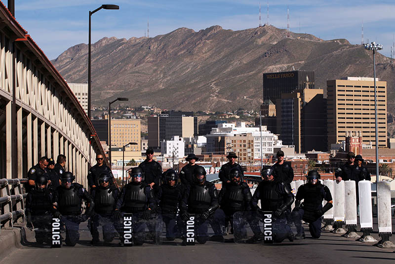 US Custom and Border Protection agents with full riot gear take part in a drill to protect the crossing gates against people who want to cross the border illegally on the international bridge between Mexico and the US, in Ciudad Juarez, Mexico October 29, 2018. Photo: Reuters