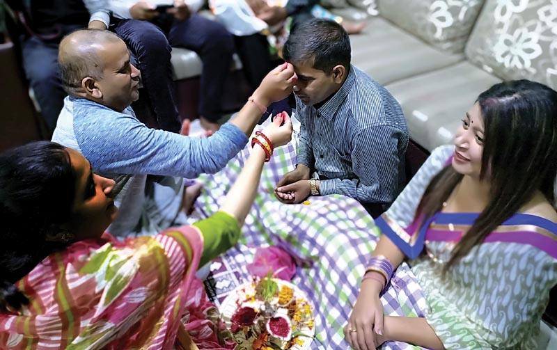 People receiving tika from elders on the day of Vijaya Dashami.