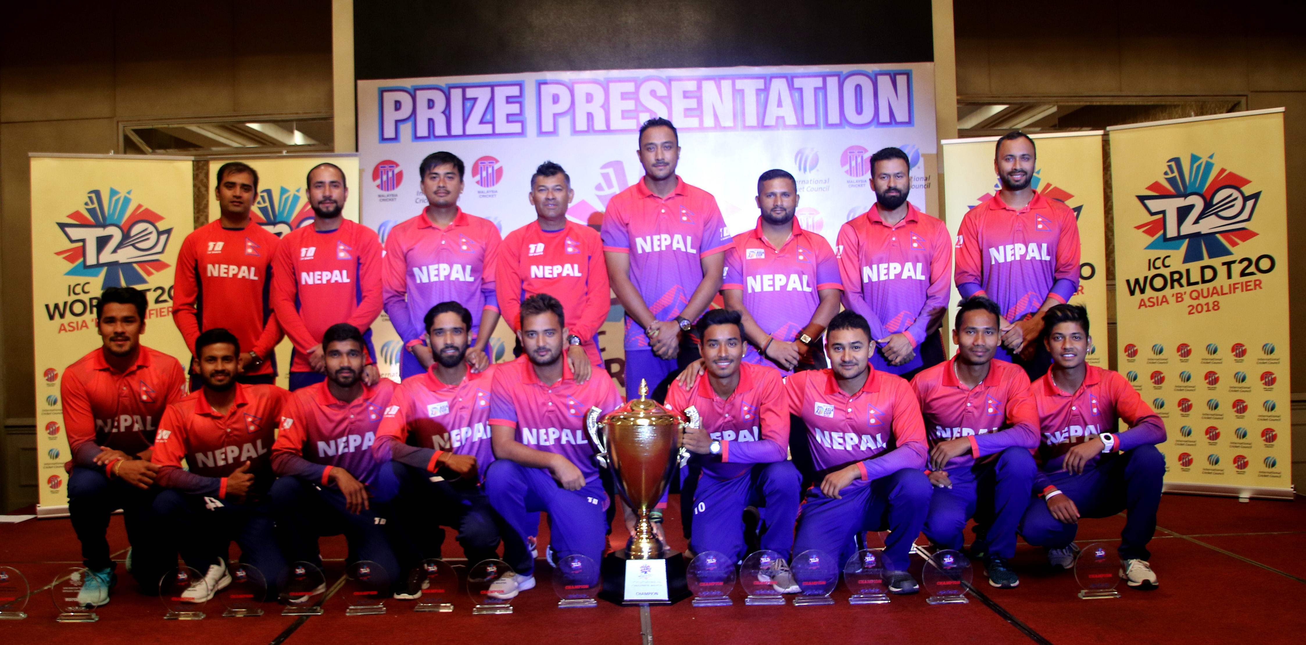 Nepal national cricket team members pose with the trophy after winning the ICC World Twenty20 Asia Region Qualifier B tournament in Kuala Lumpur, Malaysia on Friday, October 12, 2018. Photo: THT