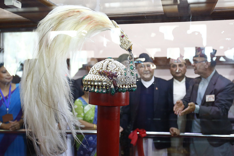 Prime Minister KP Sharma Oli observes the exhibited royal crown of former monarchs of Nepal, placed inside a bulletproof box, ten years after declaring Nepal a federal republic, at Narayanhiti Palace Museum, in Kathmandu, on Monday, October 15, 2018. Photo: Skanda Gautam/THT