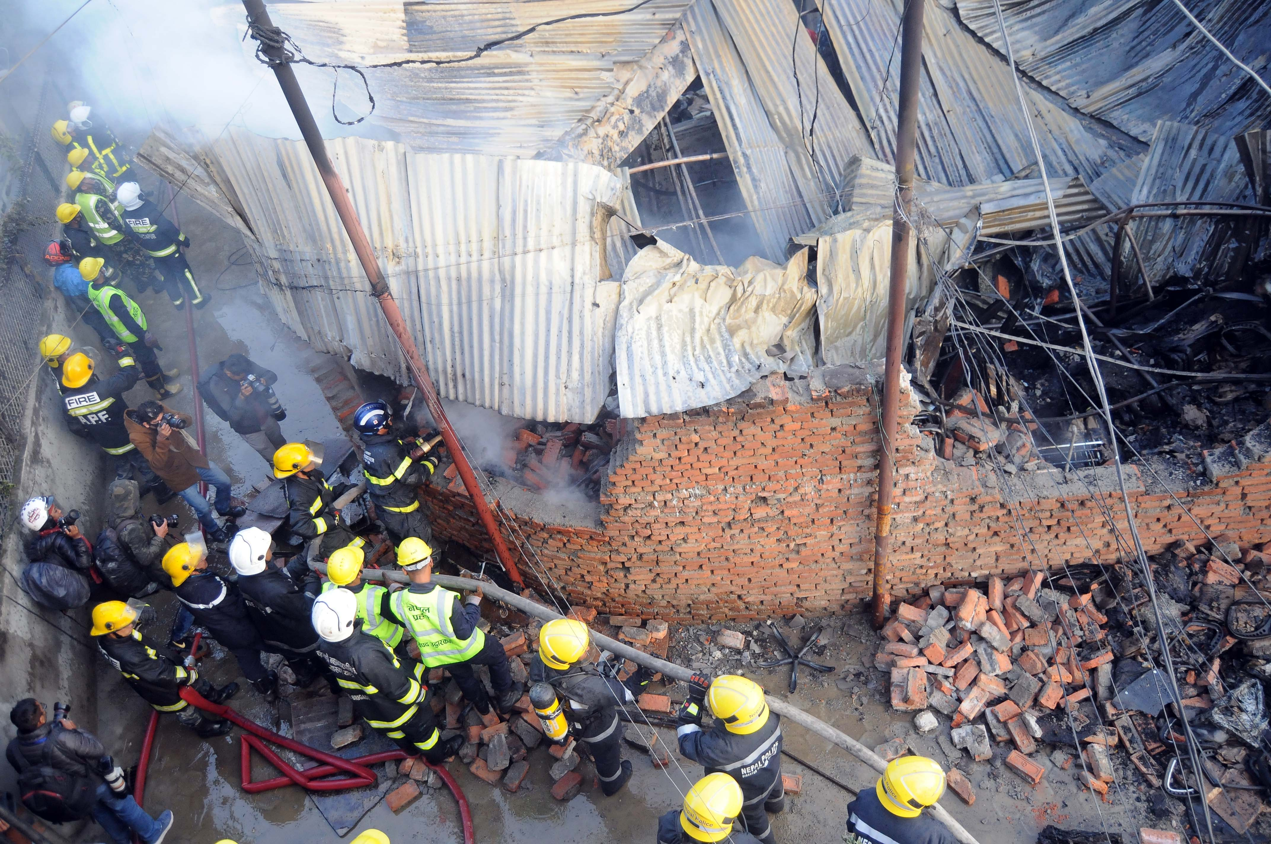Fire-fighters douse a fire at a furniture workshop in Kathmandu, On Monday, November 26, 2018. Photo: Bal Krishna Thapa/ THT