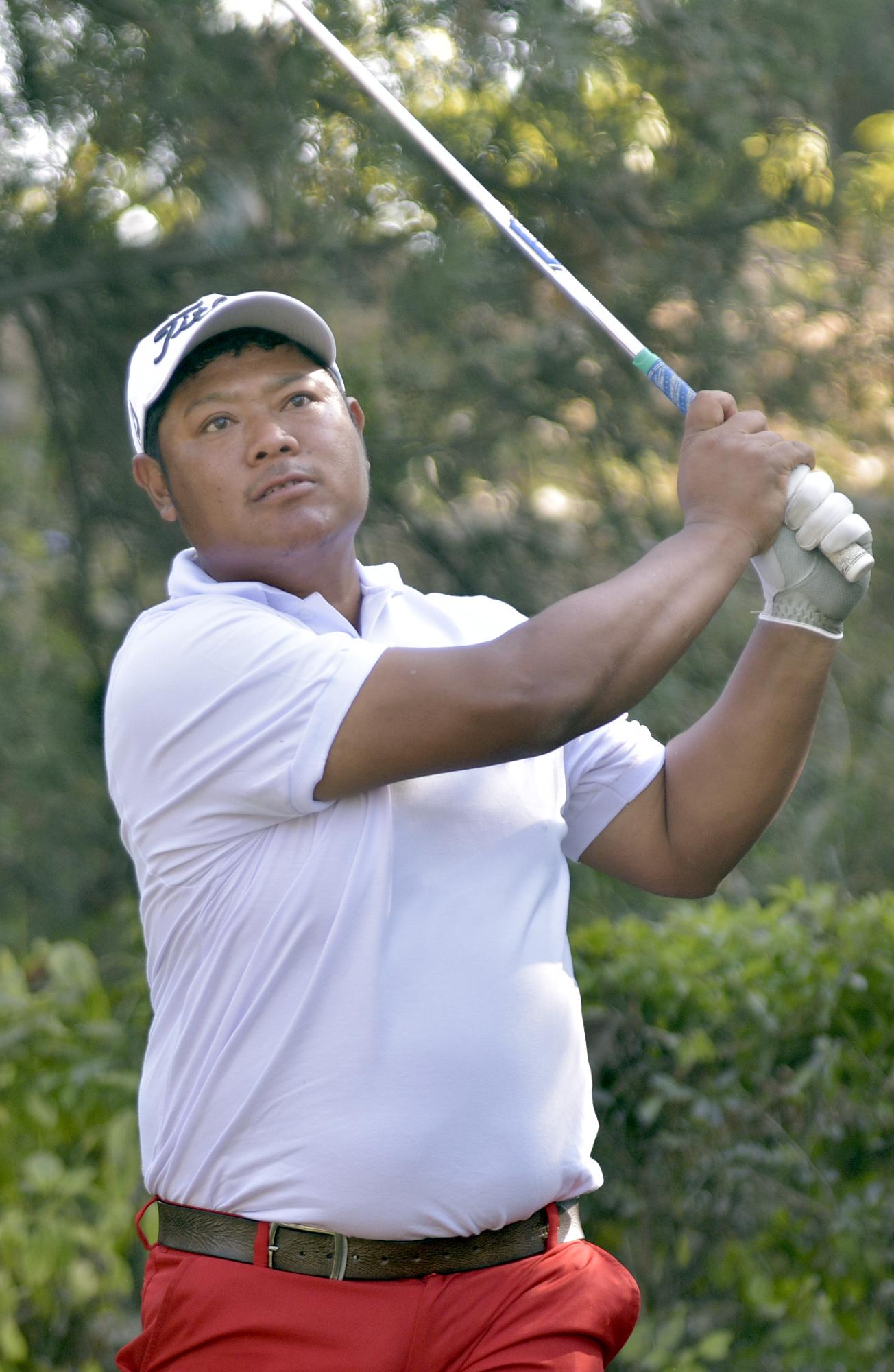 Shivaram Shrestha plays a shot on the ninth hole during the third round of the Surya Nepal Kathmandu Open at the Royal Nepal Golf Club in Kathmandu on Thursday, November 29, 2018. Photo: THT