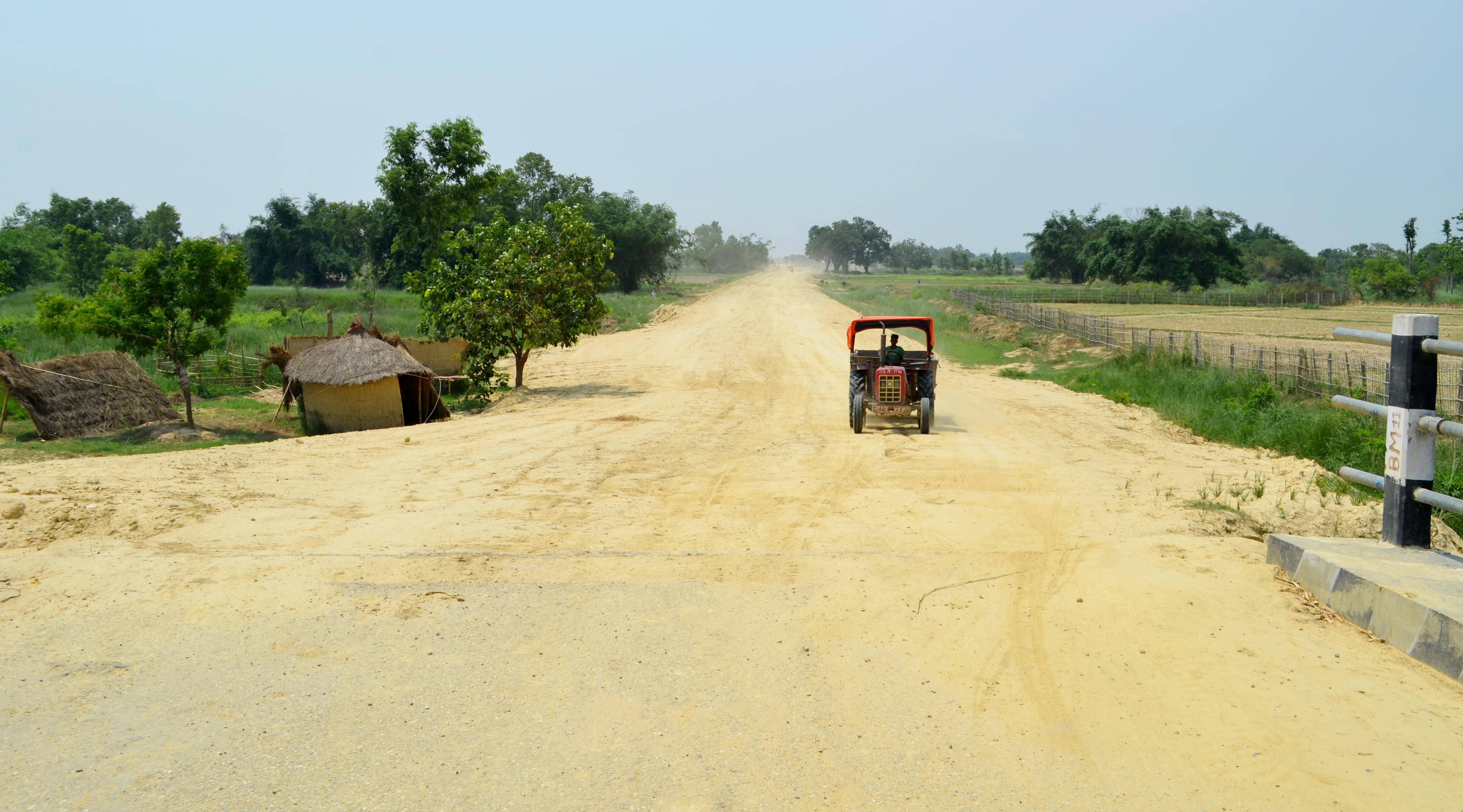 A tractor moves in a rural road section of the under construction Postal Highway which connects 20 districts in Terai belt. Photo: Ram Sarraf/Birgunj