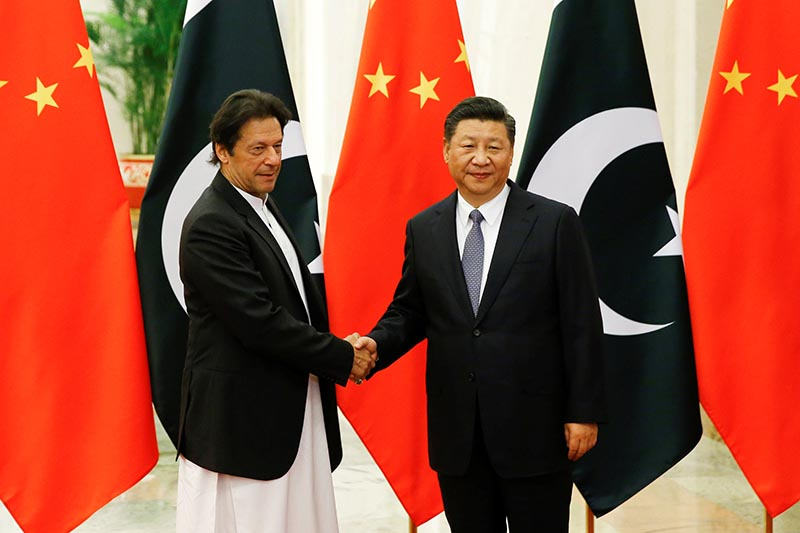 Chinese President Xi Jinping meets Pakistani Prime Minister Imran Khan at the Great Hall of the People in Beijing, November 2, 2018.  REUTERS
