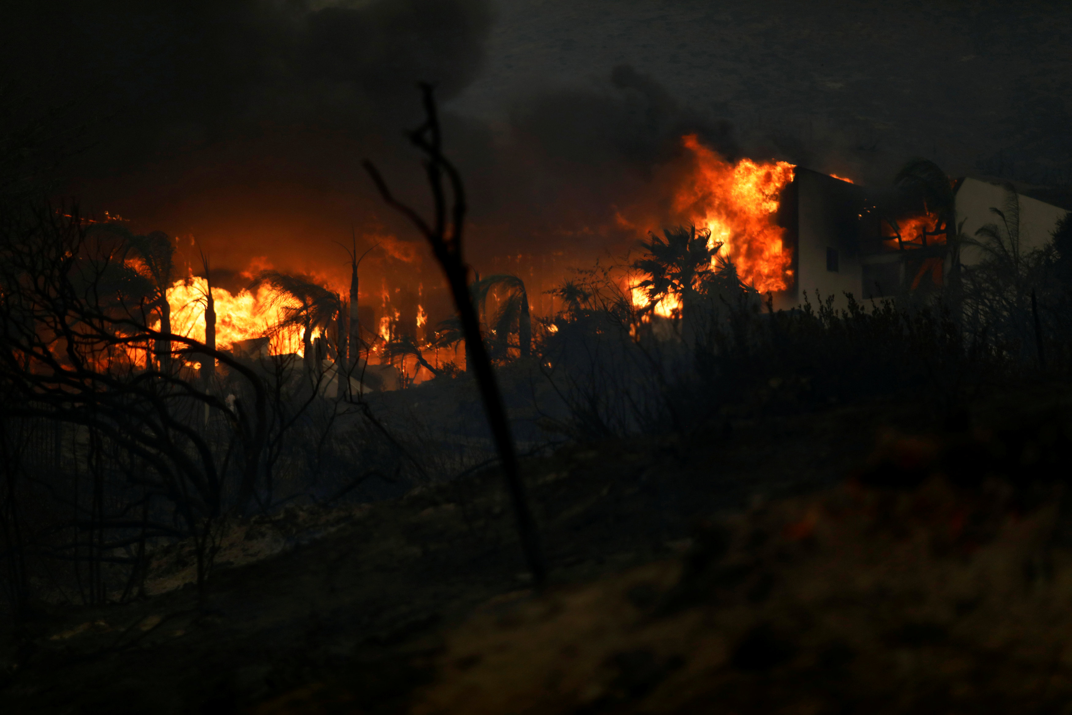 The Woolsey Fire burns in Malibu, California, US November 9, 2018. The fire destroyed dozens of structures, forced thousands of evacuations and closed a major freeway. REUTERS