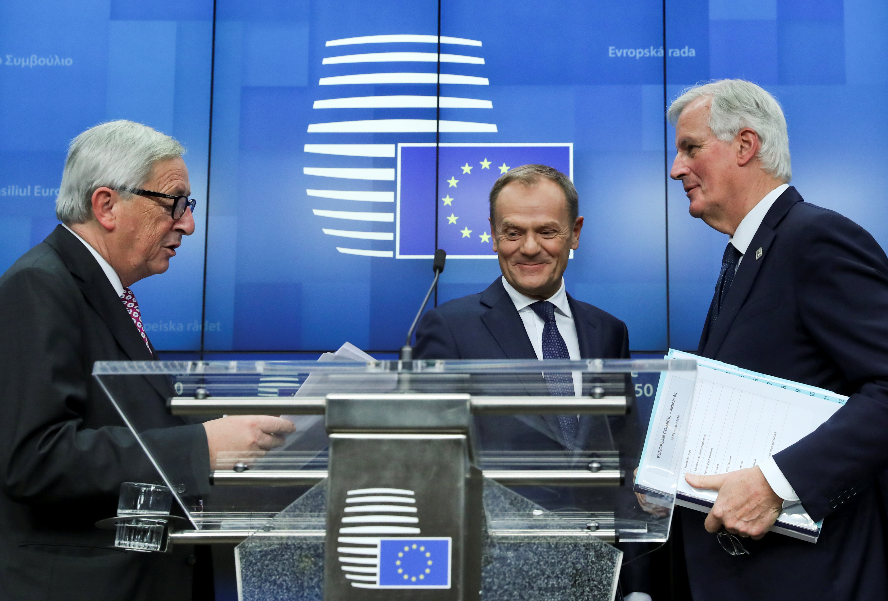 European Commission President Jean-Claude Juncker, European Council President Donald Tusk and European Union's chief Brexit negotiator Michel Barnier react during a news conference after the extraordinary EU leaders summit to finalise and formalise the Brexit agreement in Brussels, Belgium November 25, 2018. REUTERS
