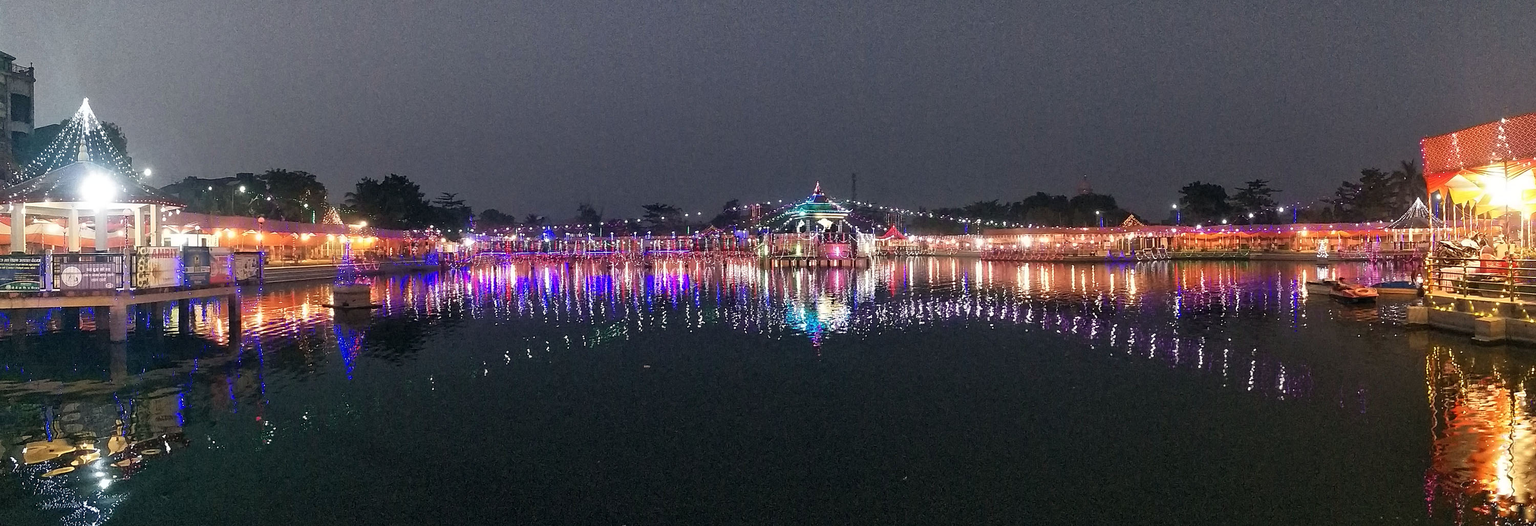 Decorative lights lit during the ongoing Chhath festival reflect over Ghadiarwa Pond in Birgunj, on Monday, November 12, 2018. More than Rs 1.4 million has been invested to decorate the pond premises for the festival, informed Chhath Management Commitee Secretary Lakhan Lal Sah. Photo: Ram Sarraf/THT