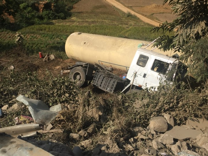 An overturned truck hauling gas bullet is pictured before it caught fire at Prithvi Highway, in Dhading, on November 11, 2018. Photo: Keshav Adhikari