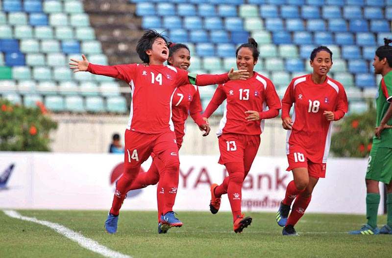 Nepali players celebrate a goal against Bangladesh during their AFC Women's Olympic Qualifying Tournament match at the Thuwanna Football Stadium in Yangon on Tuesday. Photo Courtesy: Myanmar Football Federation