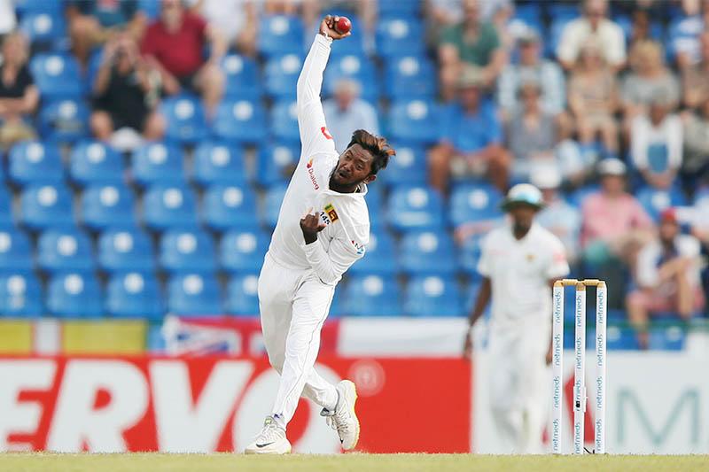 Sri Lanka's Akila Dananjaya bowls. Photo: Reuters
