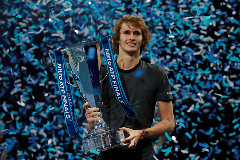 Germany's Alexander Zverev celebrates with the trophy after winning the final against Serbia's Novak Djokovic. Photo: Reuters