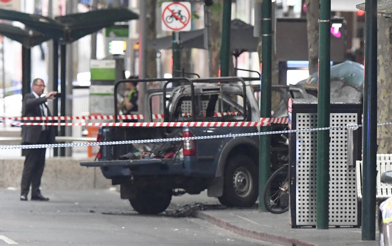 A burnt out vehicle is seen on Bourke Street in Melbourne, on Friday, Nov. 9, 2018. Photo: AP