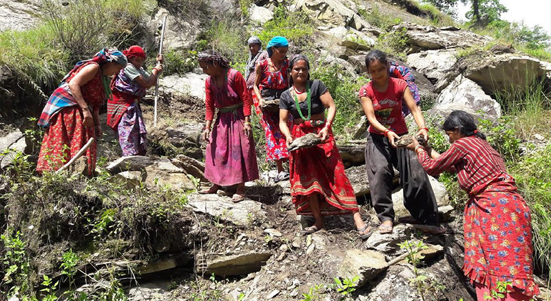 Women carrying out construction works in absence of their male counterparts at a village, in Badimalika Municipality-4, of Bajura district, on Tuesday, November 6, 2018. Photo: Prakash Singh/THT