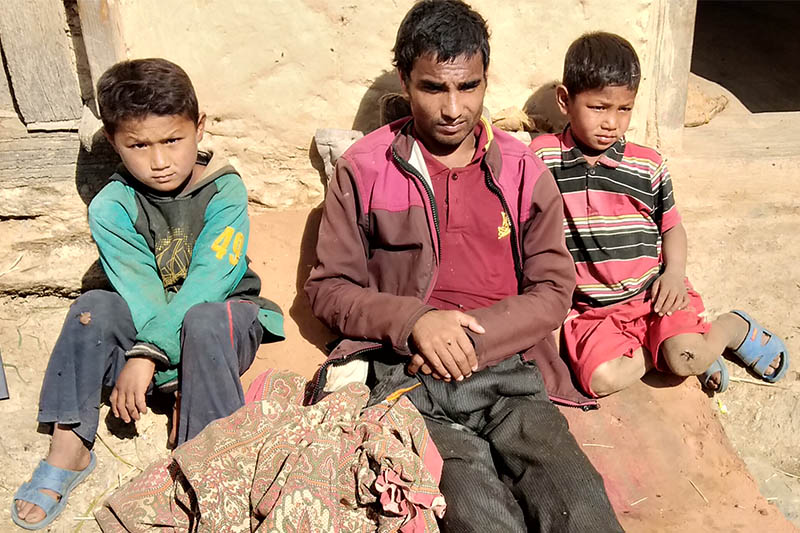 Desi Buda and his two sons sits infront of their house in Gaumul Rural Municipality-5 of Bajura district, on Friday, November 16, 2018. Photo: Prakash Singh