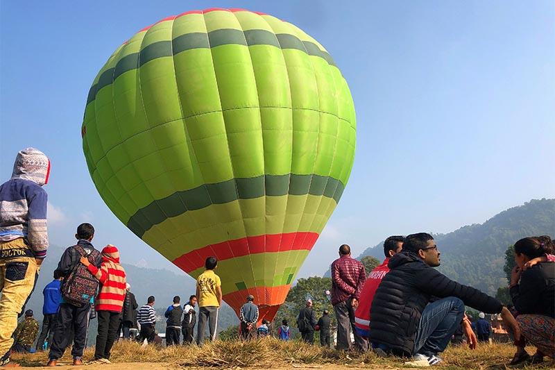 People gather around a hot air balloon during the opening ceremony of Balloon Nepal in Pokhara, Kaski district on Saturday, November 17, 2018. Photo: Skanda Gautam/THT
