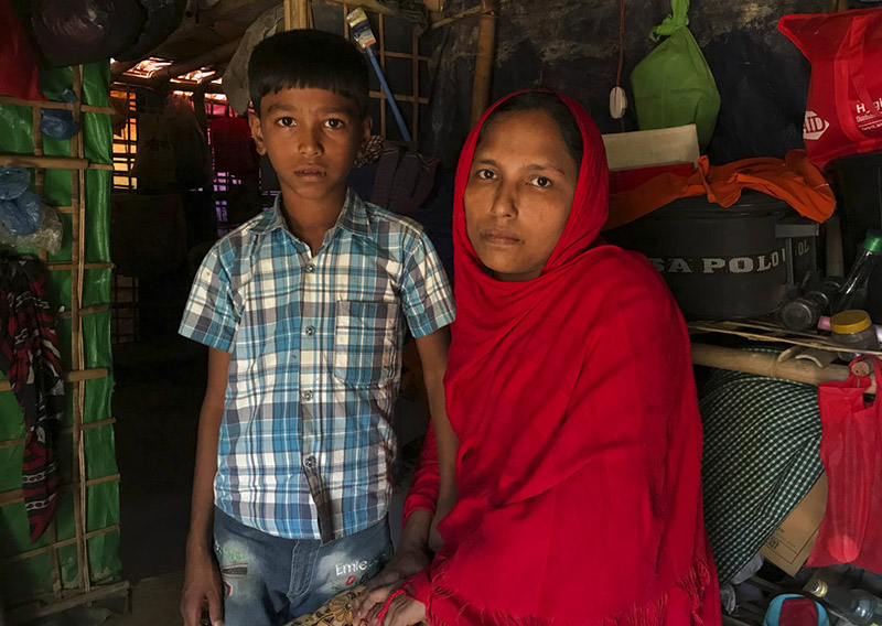 Rohingya refugee Sitara Begum with her son Mohammed Abbas, who are in the list for repatriation wait in their shelter at Jamtoli refugee camp, near Cox's Bazar, Bangladesh, on Thursday, November 15, 2018. Photo: AP