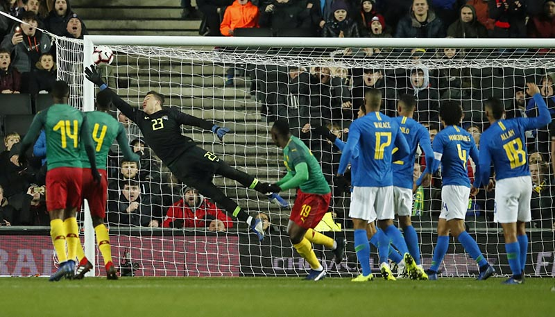 Brazil's Ederson makes a save during the International Friendly match between Brazil and Cameroon, at Stadium MK, in Milton Keynes, Britain, on November 20, 2018. Photo: Action Images via Reuters