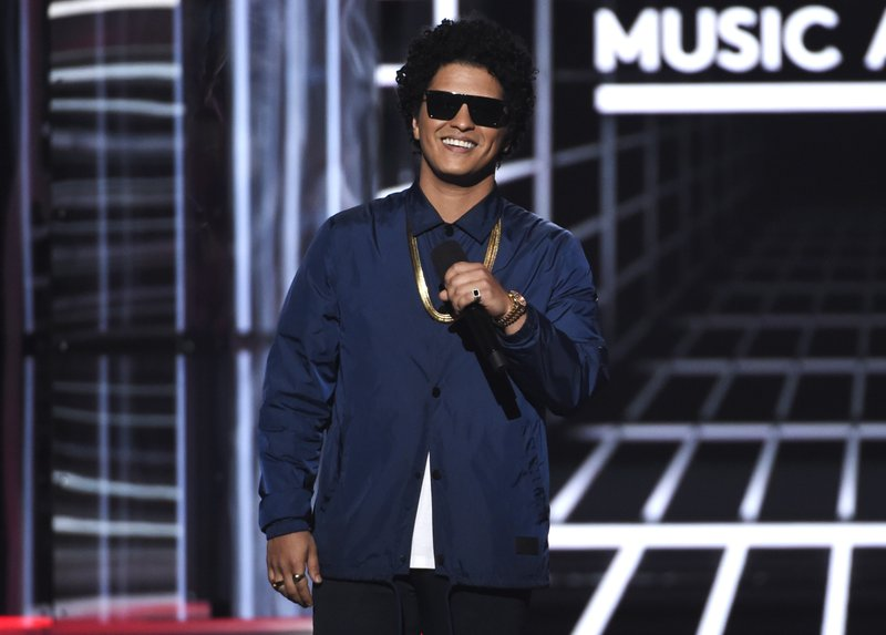 FILE - In this photo, Bruno Mars presents the Icon award at the Billboard Music Awards at the MGM Grand Garden Arena in Las Vegas on May 20, 2018. Photo: AP