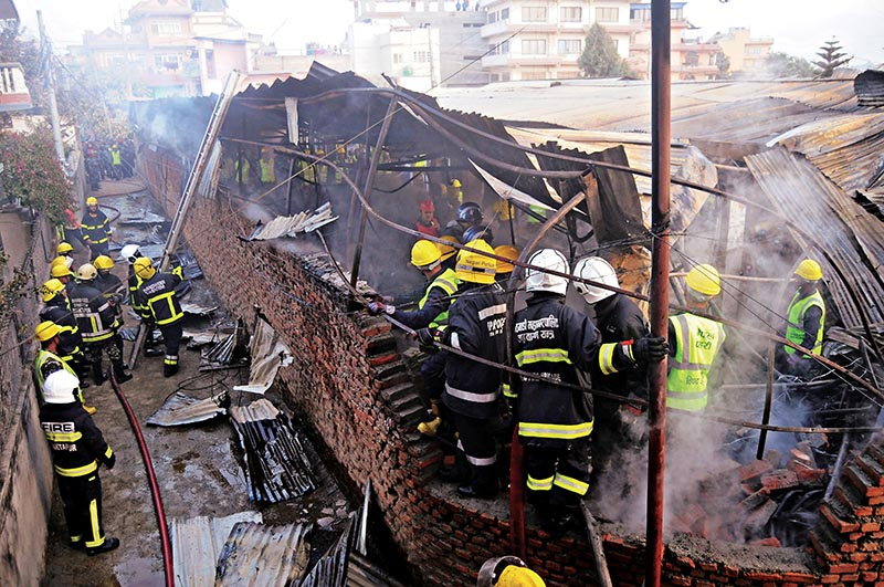 Firefighters working to extinguish the blaze that engulfed the furniture factory of Gauri Shankar Furnishing, in Buddhanagar, Kathmandu, on Monday. Photo: THT