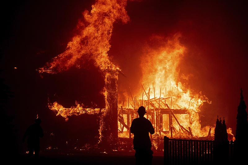 A home burns as the Camp Fire rages through Paradise, California, on Thursday, November 8, 2018. Tens of thousands of people fled a fast-moving wildfire Thursday in Northern California, some clutching babies and pets as they abandoned vehicles and struck out on foot ahead of the flames that forced the evacuation of an entire town. Photo: AP