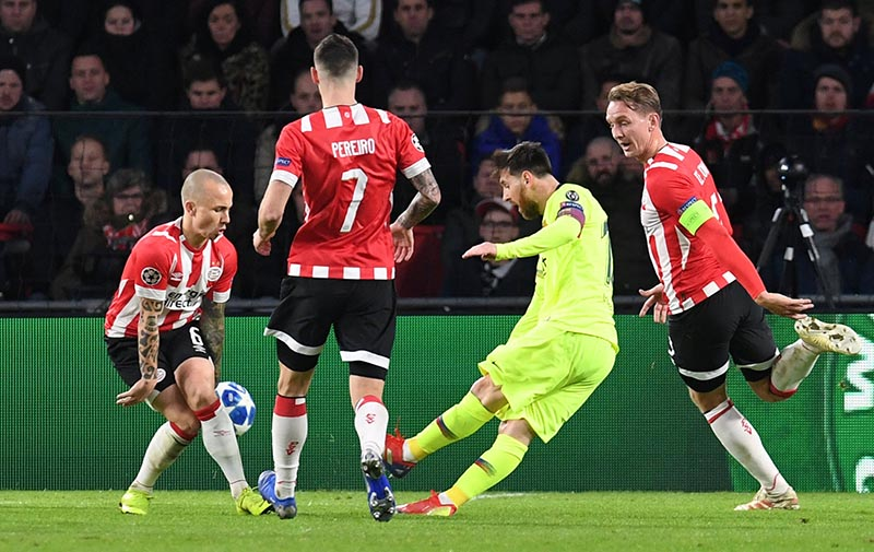 Barcelona's Lionel Messi scores their first goal during the Champions League Group Stage Group B match between PSV Eindhoven and FC Barcelona, at Philips Stadium, in Eindhoven, Netherlands, on November 28, 2018. Photo: Reuters