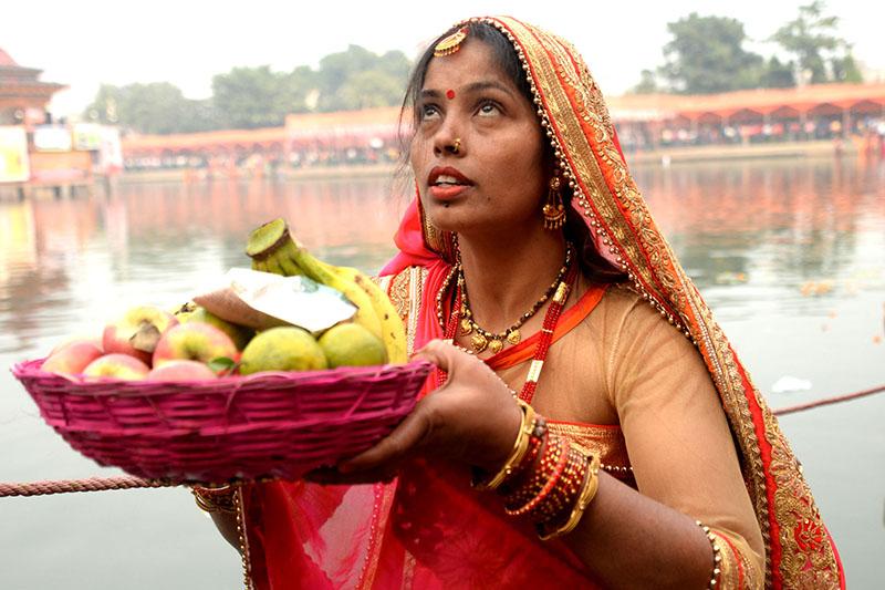 A woman worships the setting sun during Chhath festival on the banks of Ghadiarwa pond in Birgunj, on Tuesday, November 13, 2018. Photo: Ram Sarraf/THT