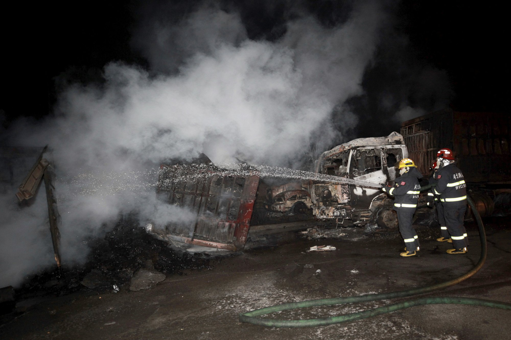 In this photo released by Xinhua News Agency, firefighters try to extinguish burning vehicles in the aftermath of an explosion at a plant operated by the Hebei Shenghua Chemical Industry Co. Ltd Wednesday, Nov. 28, 2018 in Zhangjiakou city, northeastern China's Hebei province.  Photo: AP
