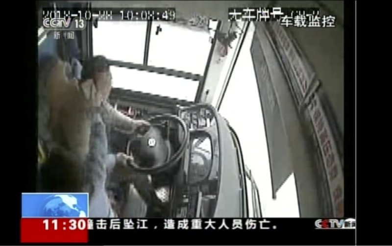 In this image taken from Sunday, Oct. 28, 2018 surveillance video footage run by China's CCTV via AP Video, a passenger strikes a bus driver with an object moments before the bus plunged off a bridge into the Yangtze River in Wanzhou in southwestern China's Chongqing Municipality. Photo: AP
