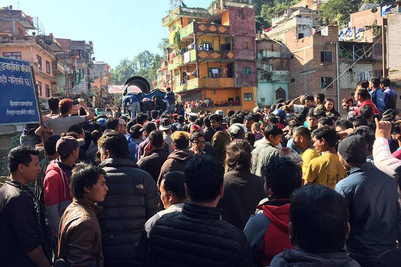Local residents gather at the incident site to look at the trucks that collided at the bridge of Puchhar Bazaar, in Nilakantha Municipality of Dhading district, on Saturday, November 3, 2018. Photo: Keshav Adhikari/THT