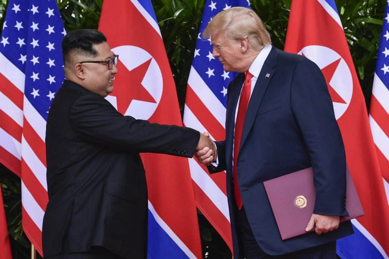FILE - In this photo, North Korean leader Kim Jong Un, left, and U.S. President Donald Trump shake hands at the conclusion of their meetings at the Capella resort on Sentosa Island in Singapore. U.S. analysts say they have located more than half of an estimated 20 secret North Korean missile development facilities on  June 12, 2018. Photo: AP