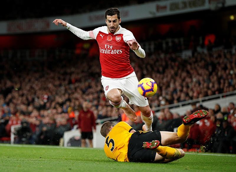 Wolverhampton Wanderers' Ryan Bennett in action with Arsenal's Henrikh Mkhitaryan during the Premier League match between Arsenal and Wolverhampton Wanderers, at Emirates Stadium, in London, Britain, on November 11, 2018. Photo: Action Images via Reuters
