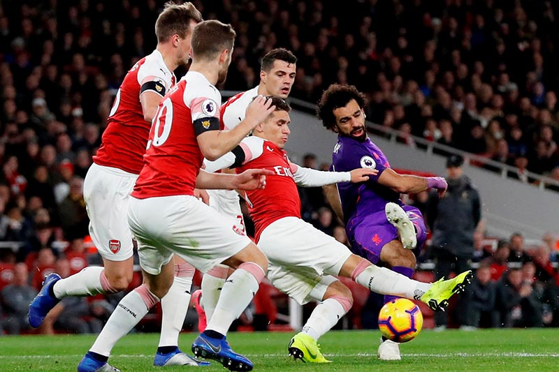 Liverpool's Mohamed Salah in action with Arsenal's Granit Xhaka, Lucas Torreira, Rob Holding and Shkodran Mustafi during the Premier League match between Arsenal and Liverpool, at Emirates Stadium, in London, Britain, on November 3, 2018. Photo: Action Images via Reuters