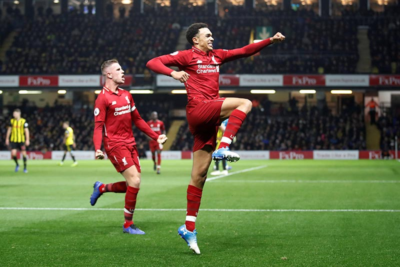 Liverpool's Trent Alexander-Arnold celebrates scoring their second goal with team mates  during the Premier League match between Watford and  Liverpool , at Vicarage Road, in Watford, Britain, on November 24, 2018. Photo: Action Images via Reuters