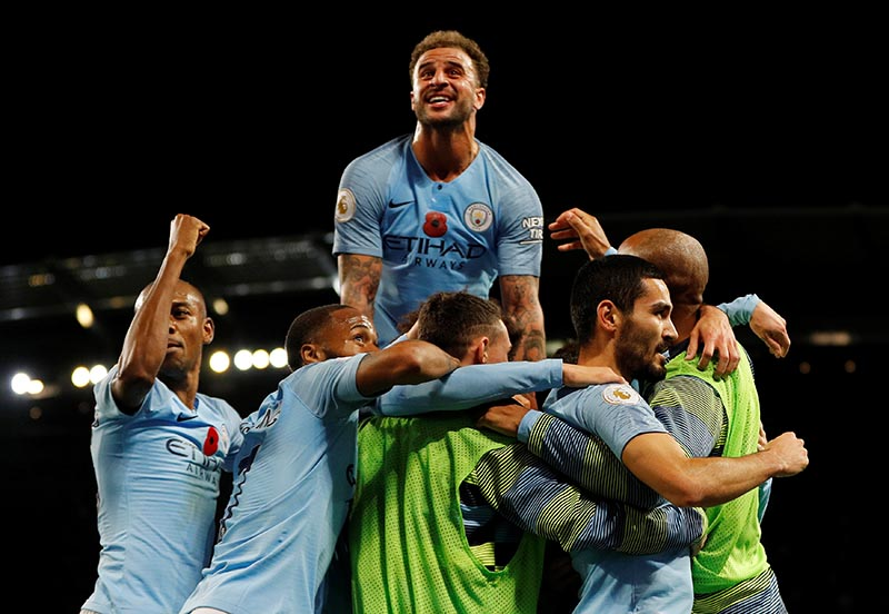 Manchester City's Ilkay Gundogan celebrates scoring their third goal with teammates during the Premier League match between Manchester City and Manchester United, at Etihad Stadium, in Manchester, Britain, on November 11, 2018. Photo: Reuters