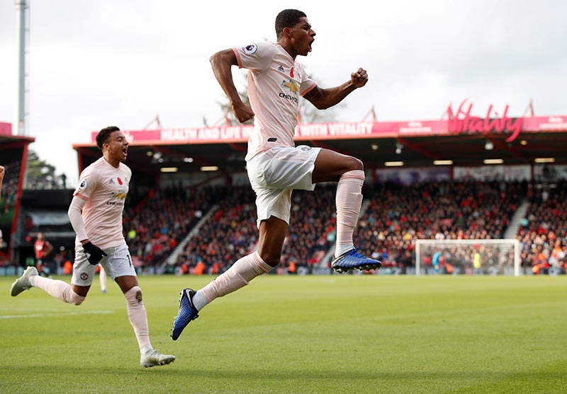 Manchester United's Marcus Rashford celebrates scoring their second goal with Jesse Lingard during Premier League match betwen AFC Bournemouth and Manchester United, at Vitality Stadium, in Bournemouth, Britain, on November 3, 2018. Photo: Action Images via Reuters