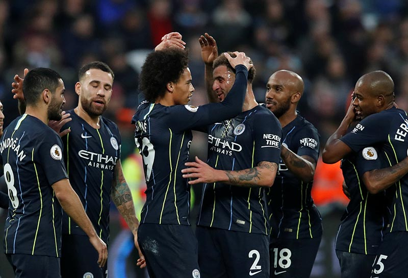 Manchester City's Leroy Sane celebrates scoring their third goal with Kyle Walker and teammates during the Premier League match between West Ham United and Manchester Cit, at  London Stadium,in  London, Britain, on November 24, 2018. Photo: Reuters