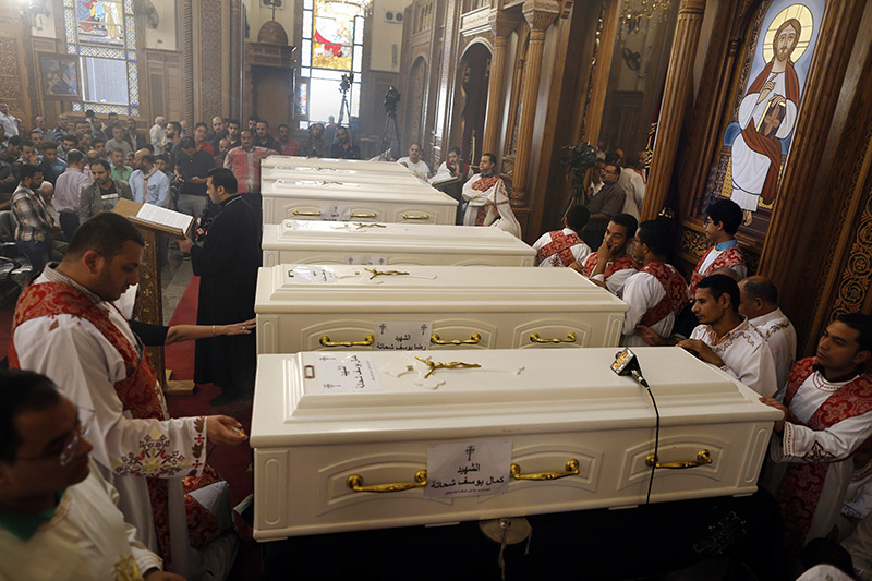 Coffins of the slain Coptic Christians are seen during their funeral service at Church of Great Martyr Prince Tadros, in Minya, Egypt, on Saturday, November 3, 2018.Coptic Christians in the Egyptian town of Minya prepared to bury their dead, a day after militants ambushed three buses carrying Christian pilgrims on their way to a remote desert monastery, killing seven and wounding 19. Photo: AP