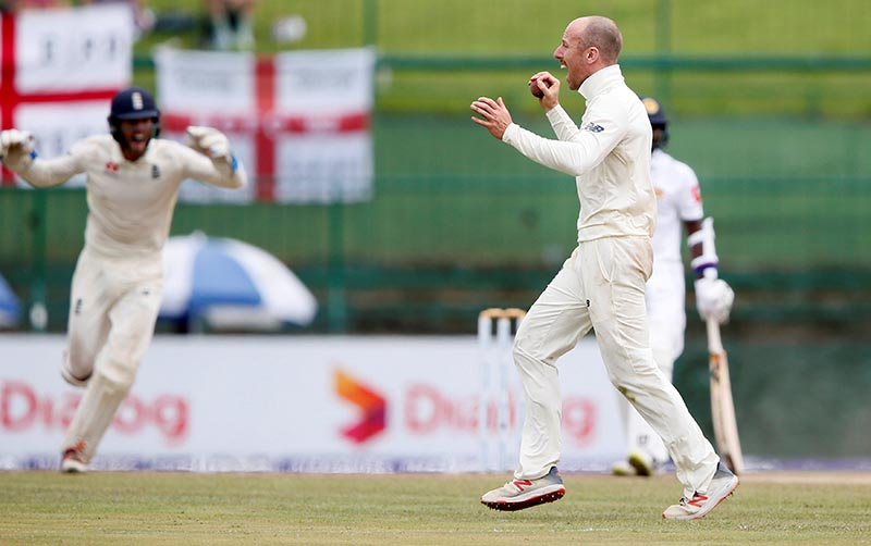 Cricket. England's Jack Leach (R) celebrates after taking the wicket of Sri Lanka's Malinda Pushpakumara (not pictured) and won the match against Sri Lanka during the Second Test match between England and Sri Lanka, at Pallekele, in Sri Lanka, on November 18, 2018. Photo: Reuters