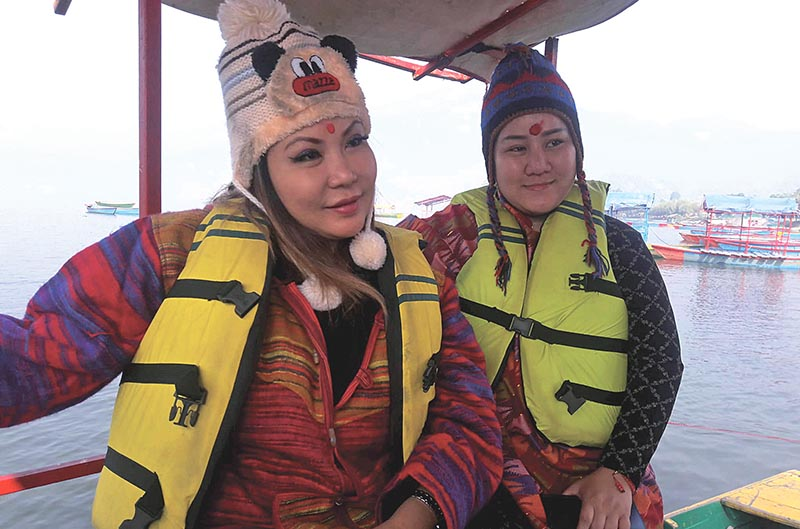 Filipino Princess Maria Amor Torres (left), who has been awarded for her social work, enjoying a boat ride in Phewa Lake, in Pokhara, on Thursday, November 22, 2018. Photo: RSS