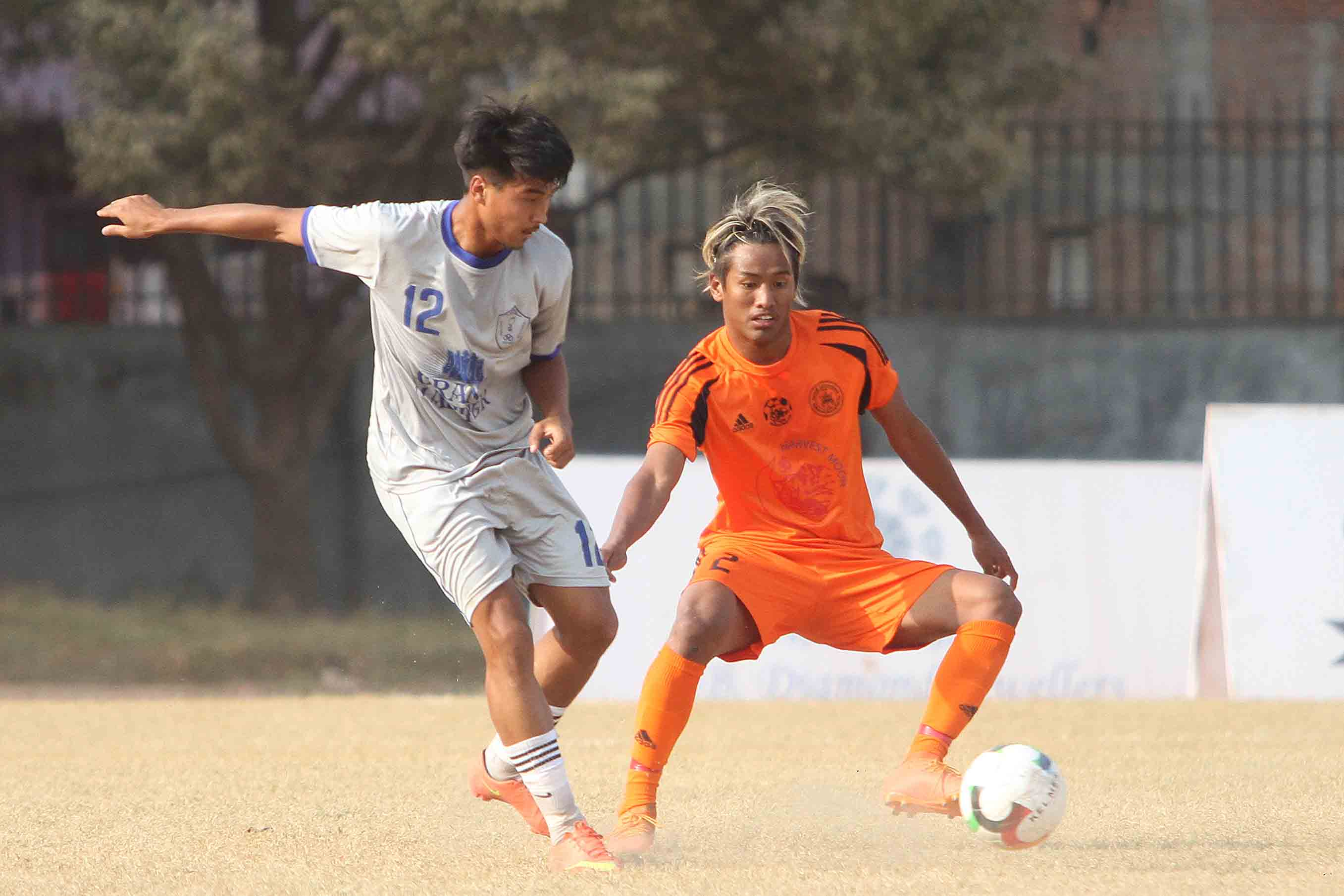 Arju Singh (left) of Jawalakhel Youth Club and Asish Gurung of Himalayan Sherpa Club vie for the ball during their Pulsar Martyru2019s Memorial u2018Au2019 Division League match at APF Football Ground in Kathmandu on Saturday. Photo: Udipt Singh Chhetry