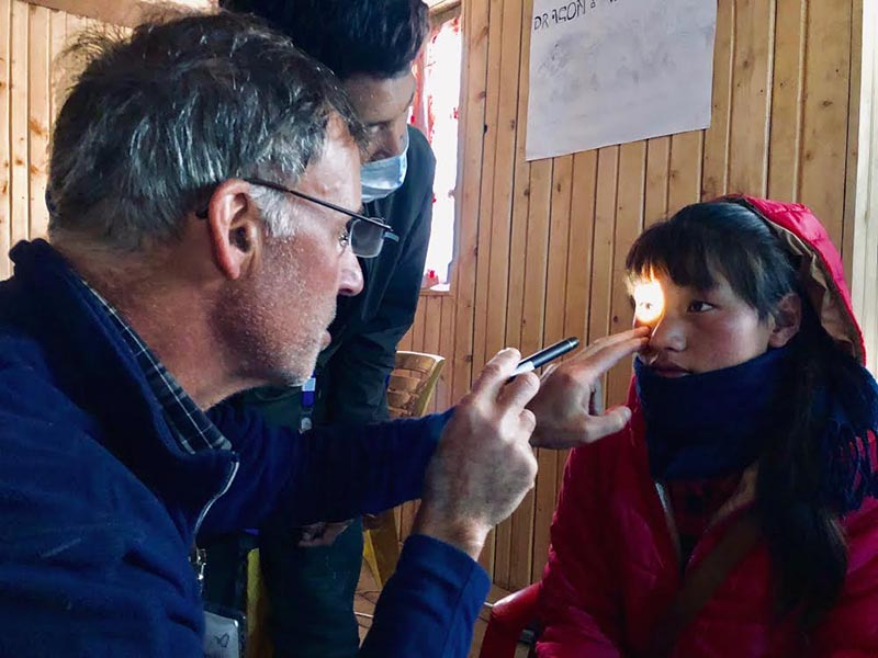 A volunteer doctor checking the eyes of a patient at Taksindu Primary School, Solukhumbu, on Wednesday, November 21, 2018. Photo courtesy: Jordan Campbell