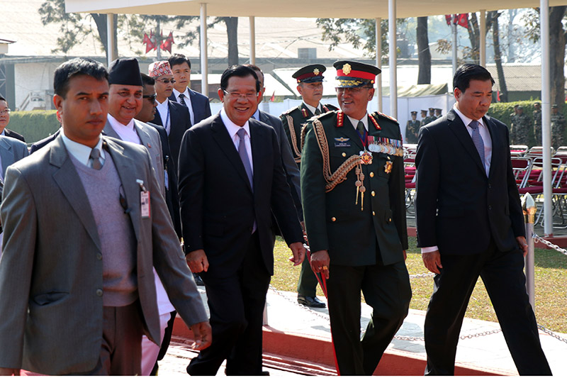 Cambodian Prime Minister Hun Sen is accompanied by Deputy Prime Minister and Defence Minister Ishwar Pokharel and Chief of Army Staff Purna Chandra Thapa, on his arrival at Trihuvan International Airport, in Kathmandu, on Thursday, November 29, 2018. Photo: RSS