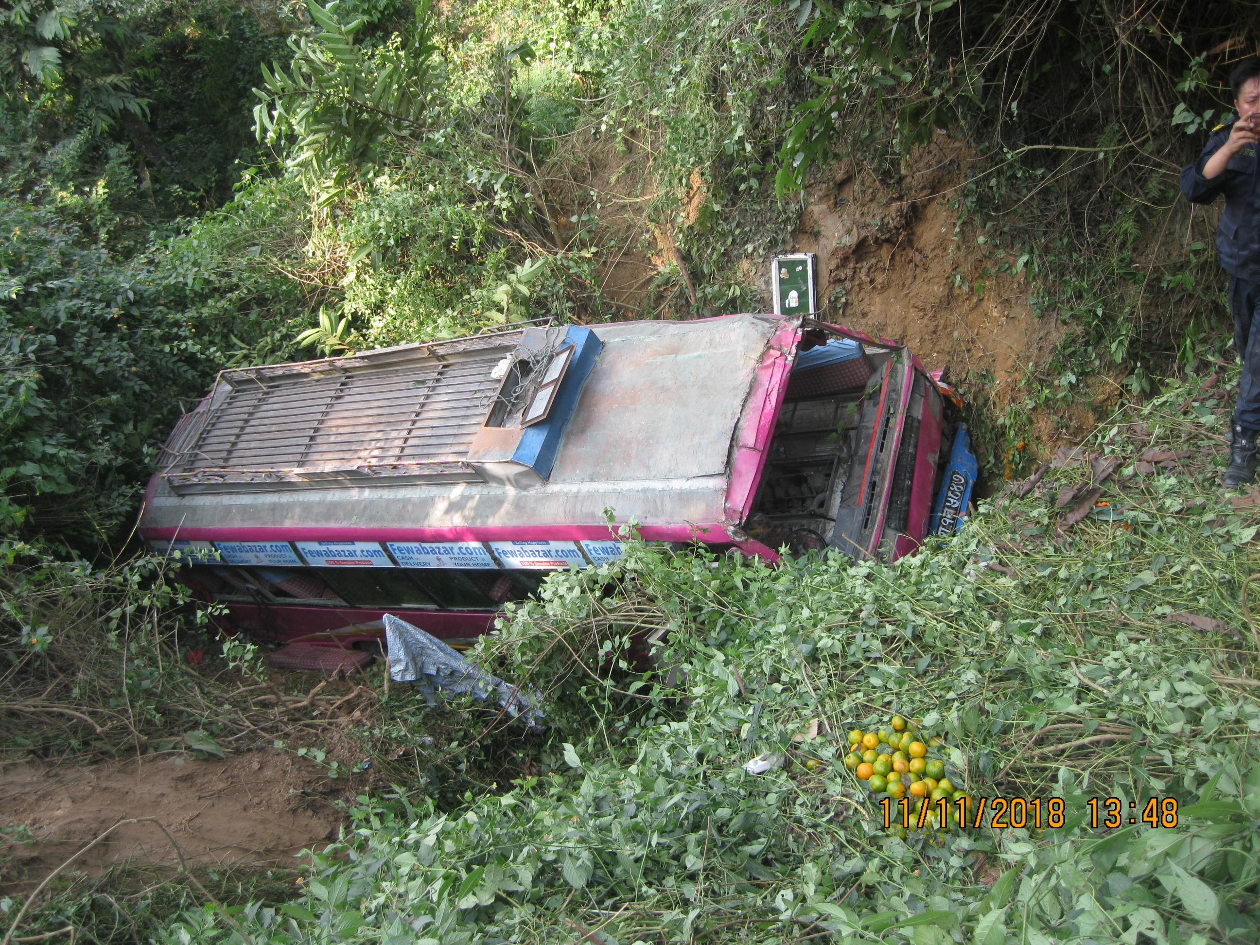 An overturned bus pictured at Kamalbari, on November 11, 2018. Photo: Madan Wagle/THT