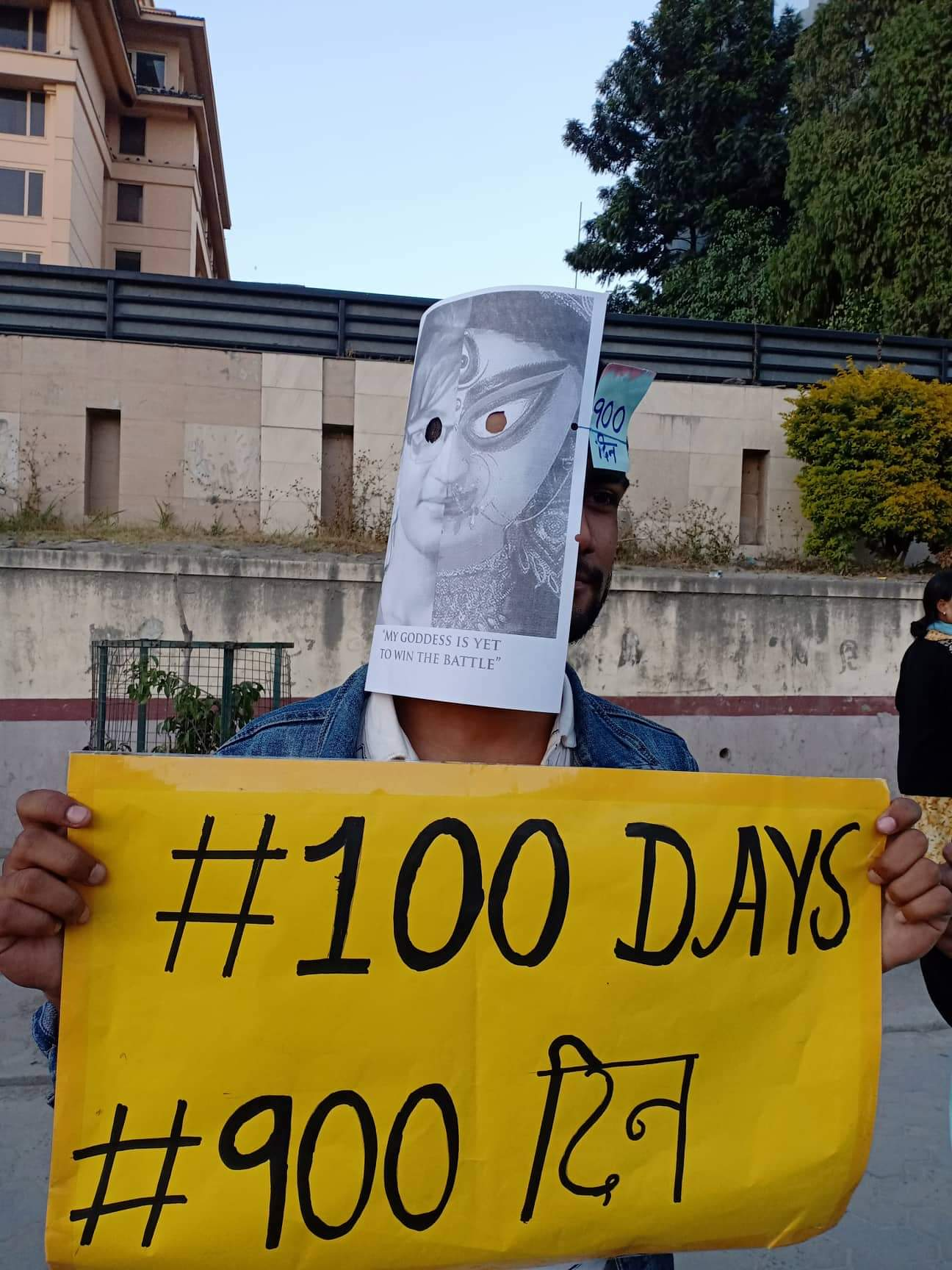 A rally participant donning Nirmala's 'mask', implying oneness at the protest programme organised today at New Baneshwar. Photo: Bijay Shiwakoti