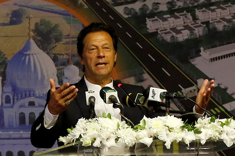 Pakistan's Prime Minister Imran Khan gestures as he speaks during the groundbreaking ceremony of the Kartarpur border corridor, which will officially open next year, in Pakistan November 28, 2018. Photo: Reuters