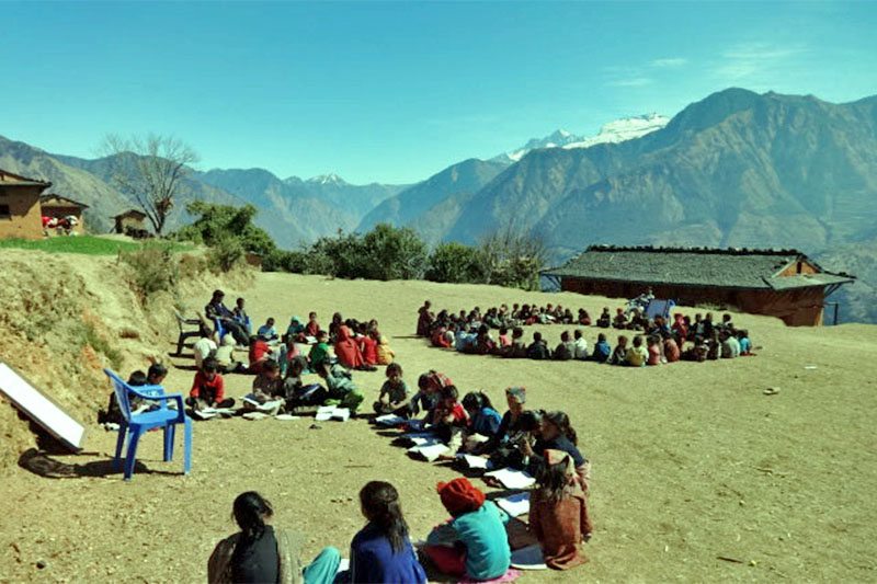 After a sudden dip in temperature, local students attend class in playground under the sun in Nalgard Municipality-8 of Jajarkot district, on Monday, November 26, 2018. Photo: RSS
