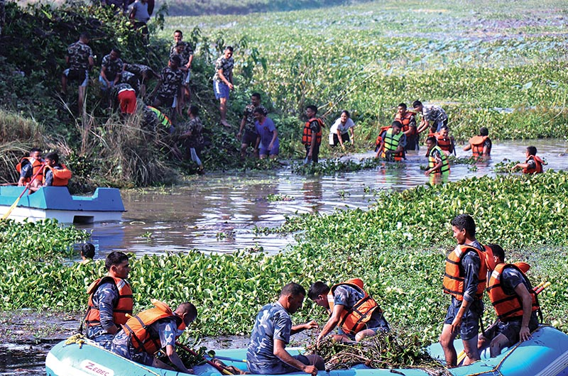 Security personnel removing water hyacinth from Jakhor Lake in Dhangadi Sub-metropolitan City, on Saturday, November 24, 2018. Photo: THT