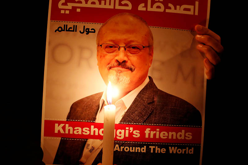 FILE PHOTO: A demonstrator holds a poster with a picture of Saudi journalist Jamal Khashoggi outside the Saudi Arabia consulate in Istanbul, Turkey October 25, 2018. Photo: Reuters